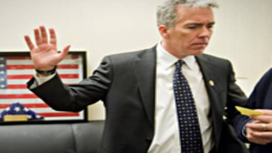 Rep. Joe Walsh, R-Ill., talks with supporter in his Cannon Building office after being sworn into the 112th Congress.