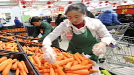 Citizens purchase goods at a supermarket in Beijing, China.