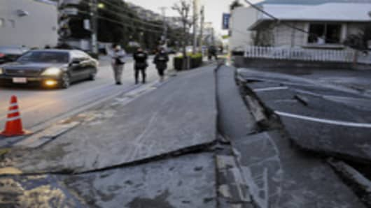 A pedestrian road has collapsed in the massive 8.9-magnitude earthquake in Urayasu city, Chiba prefecture. The earthquake shook Japan, unleashing powerful tsunamis that sent ships crashing into the shore and carried cars through the streets of coastal towns.