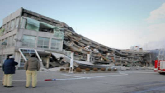 A factory building has collapsed in Sukagawa city, Fukushima prefecture, in northern Japan. A massive 8.9-magnitude earthquake shook Japan, unleashing a powerful tsunami that sent ships crashing into the shore and carried cars through the streets of coastal towns.