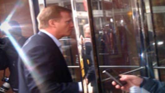 NFL commissioner Roger Goodell entering the negotiating room