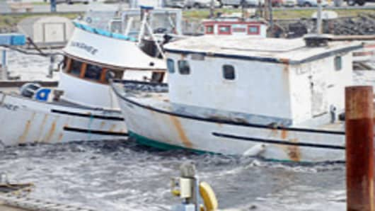Fishing boats crash into one another as tsunami surges from Japan earthquake slam into the harbor, Crescent City, California.