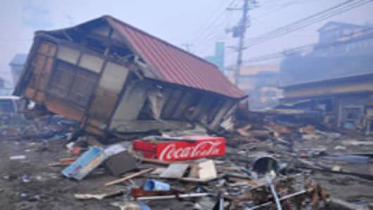 Damaged houses, cars and debris after the earthquake