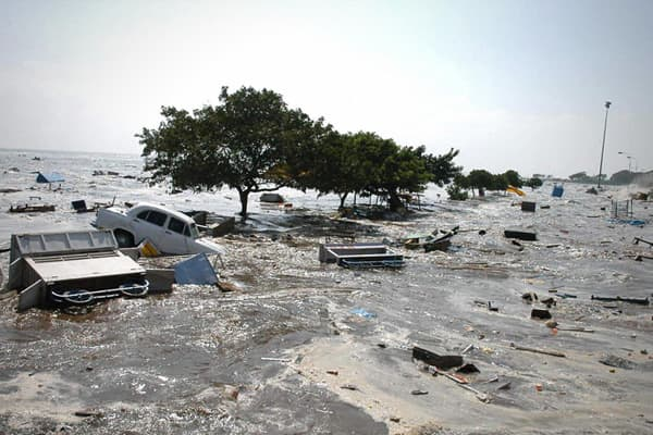 Insured losses: $1 billion Overall losses: $10 billion Fatalities: 227,898 The largest earthquake in the last 50 years was listed at a magnitude of 9.1, and killed 227,898 people from the earthquake and resulting tsunami, the deadliest tsunami in recorded history. 1.7 million people were displaced in 14 countries in Asia and East Africa with waves that reached up to 100 feet high. The energy released during the earthquake was equal to approximately 1,500 Hiroshima atomic bombs, and although ther