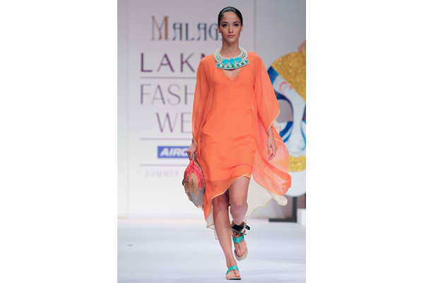 MUMBAI, INDIA - MARCH 13: A model walks the runway at the Malini Agarwalla show at Lakme Fashion Week Summer/ Resort 2011 day 3 at the Grand Hyatt on March 13, 2011 in Mumbai, India. (Photo by Chirag Wakaskar/WireImage)