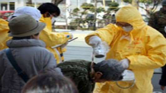 Local residents receive radiation exposure checks on March 17, 2011 in Nihonmatsu, Fukushima, Japan.