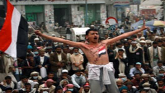 Yemenis take part in an anti-government demonstration against President Ali Abdullah Saleh