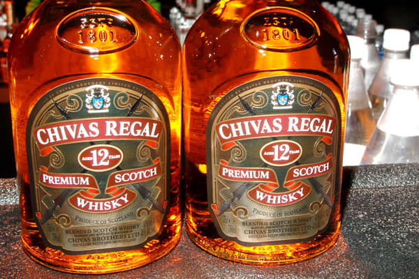 Chivas Regal is a blended Scotch whiskey produced by Chivas Brothers, owned by Pernod Ricard. James and John Chivas began producing their own blended Scotch whisky in the 1850s with the launch of 'Royal Glen Dee'. Only in the early 1900s did the whisky's name change to Chivas Regal when brothers decided to export to the U.S.