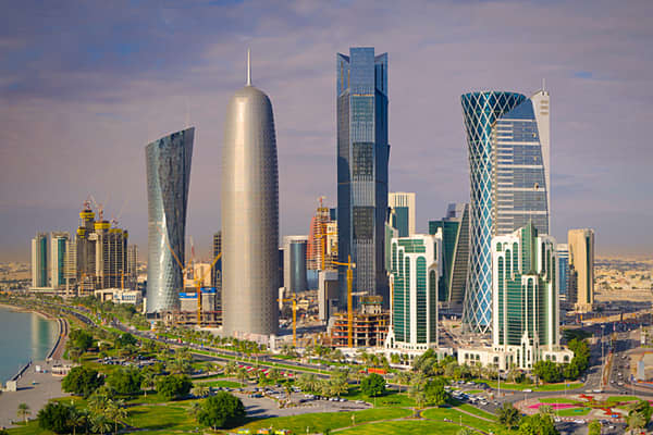 """Doha, the capital city of Qatar, is home to approximately 80% of the country's population. Qatar's largest energy companies, including Qatar Petroleum, Qatargas and RasGas are headquartered in Doha. In recent years, due to a """"modernization"""" program by Sheikh Hamad bin Khalifa Al Thani, the Qatari economy is trying to diversify away from oil and natural gas. As a result, the city has experienced a real estate boom, a population boom , and an influx of corporate and commercial activity. The city i"""