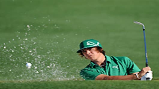 Rickie Fowler plays from a bunker on the second hole during the first round of the 2011 Masters Tournament at Augusta National Golf Club on April 7, 2011.