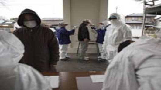 A man undergoes a screening test for possible nuclear radiation at screening center about 35 kilometers away from Fukushima Nuclear Power Planton on April 9, 2011 in Minamisoma, Fukushima Prefecture, Japan. The 9.0 magnitude strong earthquake struck offshore on March 11 at 2:46pm local time, triggering a tsunami wave of up to ten metres which engulfed large parts of north-eastern Japan, and also damaging the Fukushima nuclear plant and threatening a nuclear catastrophe. The death toll continues