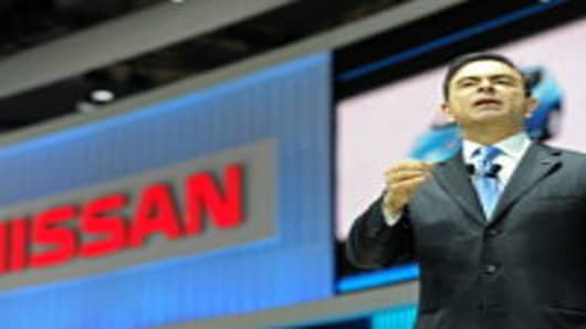 Nissan CEO Carlos Ghosn addresses a press conference at the Shanghai Auto Show.