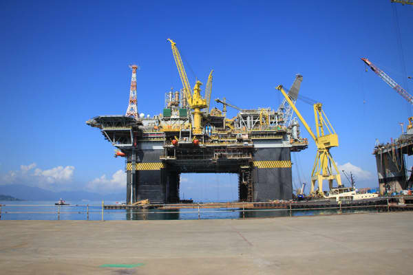 Pictured left, the new Petrobras semi-submersible platform dubbed P-56. It is being constructed in the resort town of Angra dos Reis in Brazil.
