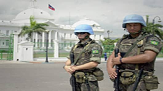 Brazilian army soldiers acting as U.N. peacekeepers in front of the presidential palace in Port-au-Prince, Haiti.