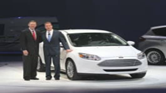 Ford President and CEO Alan Mulally (L) and Executive Chairman William Clay Ford unveil a new 2011 Ford Focus during the press preview of the North American International Auto Show at the Cobo Center in January, 2011 in Detroit, Michigan.