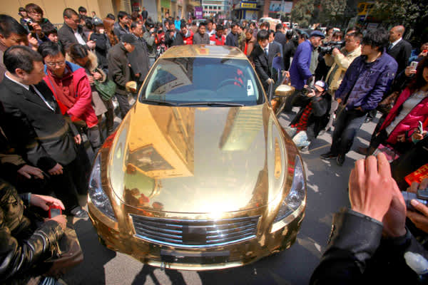 This Infiniti convertible plated with 24k gold was unveiled in March 2011 at a jewelers shop in Nanjing in the eastern Chinese province of  Jiangsu.According to local reports, it took five artisans four months to give the car its full bling. The car was later towed away from outside the store for not having been properly registered.