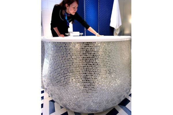Splish splash away in style in this bathtub made with 24k white gold tiles.It was designed by Japanese manufacturer INAX and put on display in the company's Tokyo showroom in August 2010. The price tag: $94,000.