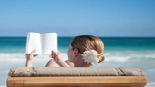 woman_reading_on_beach_200.jpg