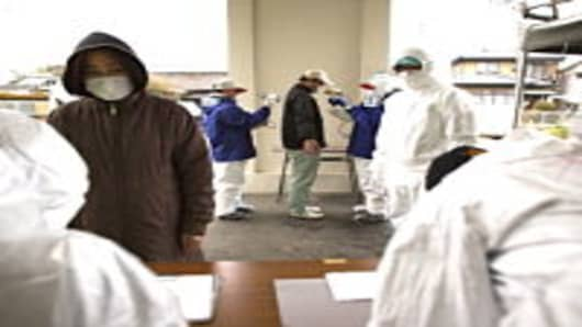 A man undergoes a screening test for possible nuclear radiation at screening center about 35 kilometers away from Fukushima Nuclear Power Plant.