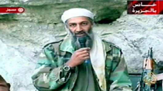 Saudi-born alleged terror mastermind Osama bin Laden is seen in this video footage recorded at an undisclosed location in Afghanistan aired by the Qatar-based satelite TV station al-Jazeera in 2001.
