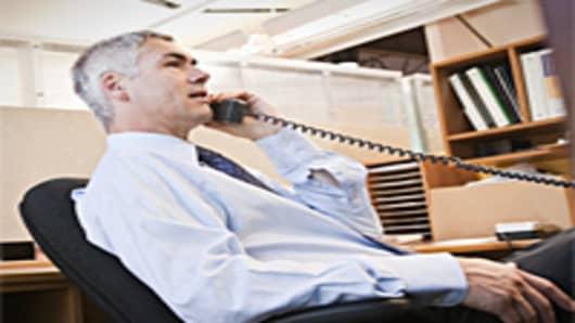 man_on_office_phone2_200.jpg