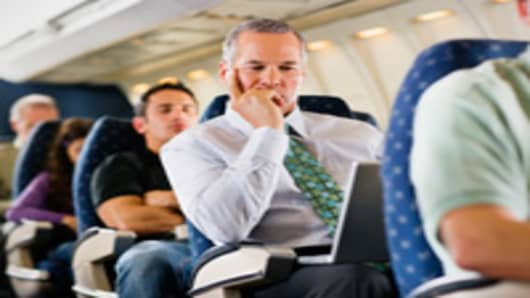businessman_airplane_laptop_200.jpg