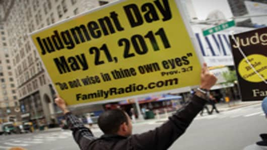 Participants in a movement that is proselytizing that the world will end this May 21, Judgment Day, gather on a street corner on May 13, 2011 in New York City. The Christian based movement, which claims thousands of supporters around the country and world.