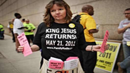 Julie Baker walks the streets proselytizing with other believers that the world will end this May 21, Judgment Day in New York City. The Christian based movement, which claims thousands of supporters around the country and world, was founded by the Oakland, Calif.-based Harold Camping.