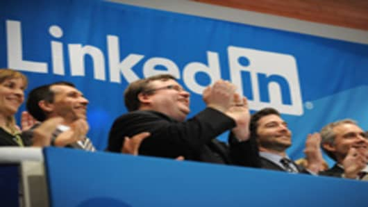 Linkedin founder Reid Garrett Hoffman (C) and CEO Jeff Weiner (2nd R) at the ringing of the opening bell of the New York Stock Exchange May 19, 2011 during the initial public offering of the company.