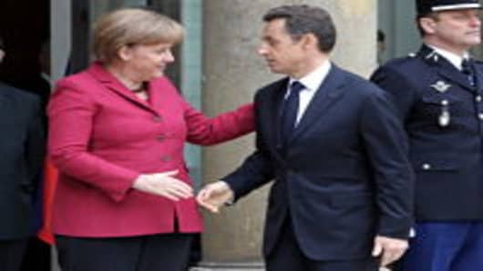 German Chancellor Angela Merkel (L) is welcomed by France's President Nicolas Sarkozy as she arrives on at the Elysee Palace in Paris in this photo from March, 2011.