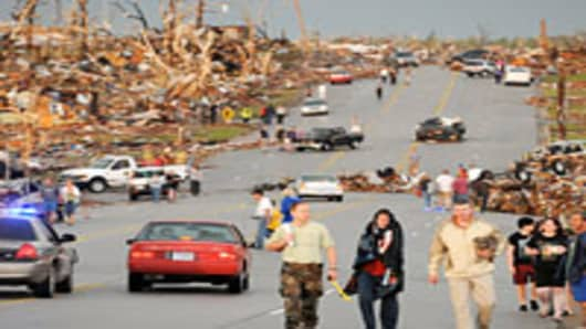 Residents walking down street after a tornado in Joplin, Missouri.