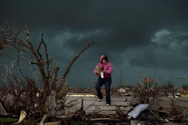 Janet Martin attempts to salvage medication and mementos from her brother's home before a second storm moves in, on May 23, 2011 in Joplin, Missouri. 'Twenty minutes before the storm, he left to go to church. He would have been in that basement if he hadn't gone,' Martin said.