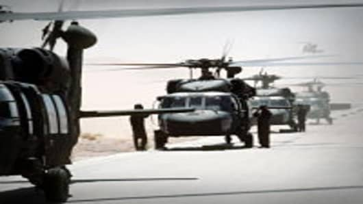 FILE PHOTO: UH-60A Black Hawk helicopters prepare to takeoff as the 82nd Aviation Brigade relocates in the desert during Operation Desert Shield. (photo by DOD)