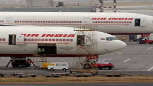 Air India aircrafts are seen parked on the tarmac of the international airport in Mumbai on April 29, 2011. Air India on April 28 sought a court order against striking pilots as a stoppage over pay entered a second day, grounding dozens of flights and causing widespread disruption for passengers. AFP PHOTO/Punit PARANJPE (Photo credit should read PUNIT PARANJPE/AFP/Getty Images)