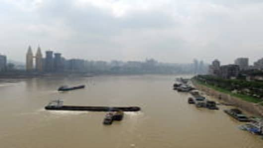 A cargo vessel runs aground at the Chongqing section of the Yangtze River during a low water period on May 3, 2011 in Chongqing, China. The vessel is carrying a cargo of 2,500 tons of steel.