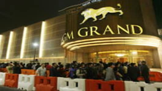 Crowds wait outside for the opening of the MGM Grand in Macau in December 2007.