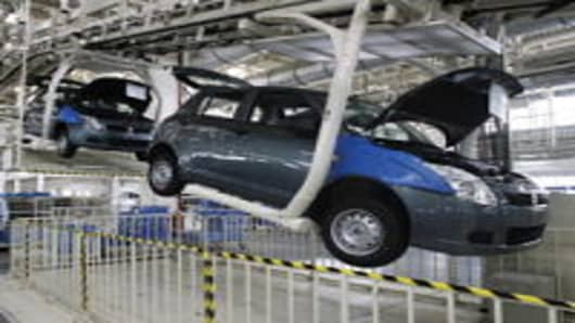 Maruti-Suzuki Swift cars roll off the assembly line at at the new autoplant at Manesar in India's Haryana state some 50 kms South of New Delhi.
