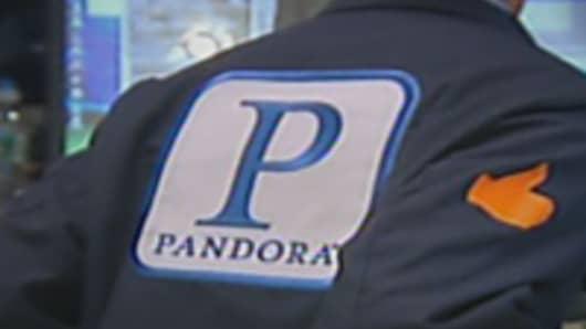 Pandora trader wearing single symbol P on his jacket at the NYSE