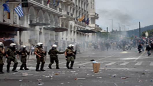 Demonstrators and riot police clash during a protest against plans for new austerity measures.