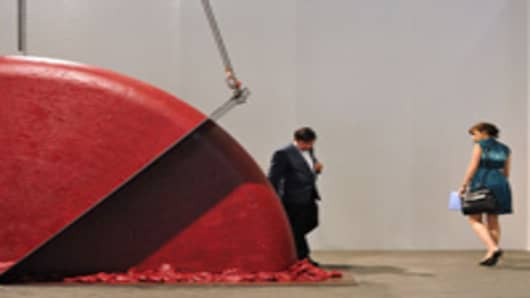 BASEL, SWITZERLAND - JUNE 14: Two vistors look at the Anish Kapoor, Push - Pull, 2008 artwork on June 14, 2011 in Basel, Switzerland. 300 art galleries selected by the fair will display works by more than 2,500 artists to 60,000 art enthusiasts during this 42nd edition of Art Basel, the most prestigious art fair in the world, which runs until the 19th of June 2011. (Photo by Harold Cunningham/Getty Images)