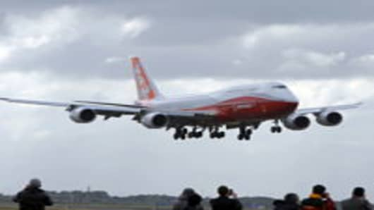 The new Boeing 747-8 Intercontinental lands at Le Bourget airport near Paris.