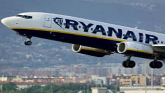 An airplane of the Irish low-cost airline Ryanair takes off from Barcelona's airport.