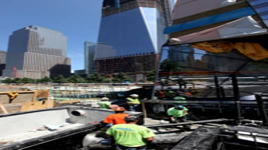 Work continues on the National September 11 Memorial & Museum at the World Trade Center site on June 30, 2011 in New York City. The memorial features two reflecting pools on the footprints of the twin towers. The memorial  is scheduled to be dedicated on September 11, 2011, the tenth anniversary of the World Trade Center terrorist attacks.