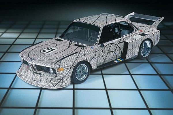 The second BMW Art Car was created by American artist and passionate motor racing fan Frank Stella. During the design conception, the American artist switched gears from his usual random style of painting and sought inspiration for the vehicle's technical aura. The result: a black and white square quid with an evenness and precision reminiscent of oversized graph paper.Within this grid, pattern-like, dotted lines run across the bodywork, suggesting that Stella may have wished to cut out the car
