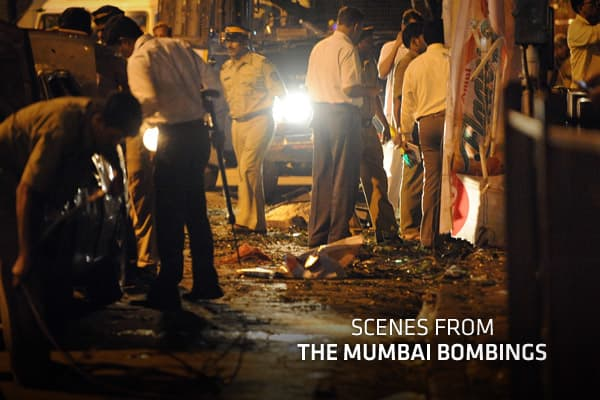 Near-simultaneous bomb blasts rocked three busy neighborhoods during evening rush hour in India's busy financial capital Wednesday, killing at least 17 people in what the government called an apparent terrorist attack on the city beseiged by militants nearly three years ago.The first blast struck the Jhaveri Bazaar at 6.54 p.m., tearing through the famed jewelry market. A minute later, a second blast hit the busy business district of Opera House, several miles away in southern Mumbai. At 7:05 p.