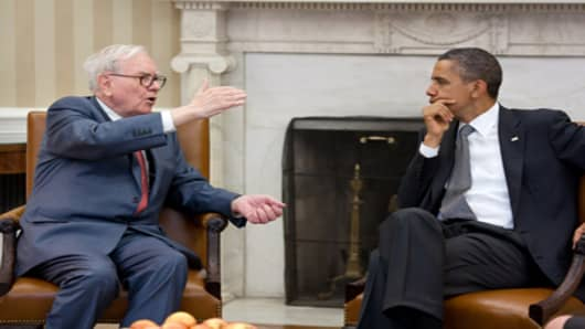 Warren Buffett meets with President Obama in the Oval Office on July 18, 2011/