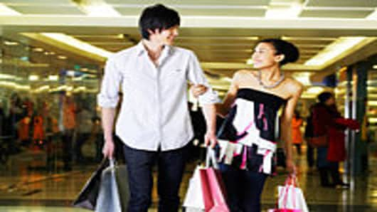 Man and woman with shopping bags in mall