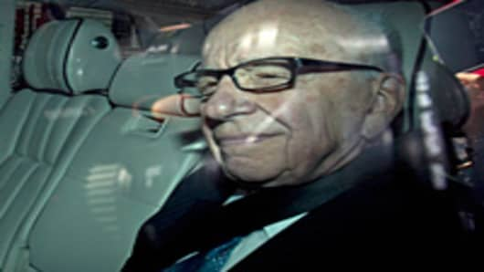 Rupert Murdoch, chief executive officer of News Corp., sits in a car as he is driven along Whitehall, prior to a parliamentary committee hearing on the phone hacking scandal.