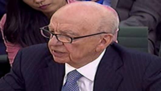Rupert Murdoch speaks before Parliament.