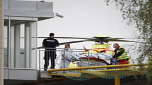 A person wounded in the shooting at the Labour Youth League summer camp in Utoeya is stretchered off an helicopter upon arrival at an Oslo hospital.